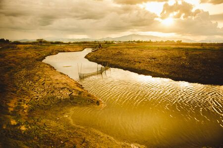 The water in canal is drying, Water crisis and Climate change or drought concept.