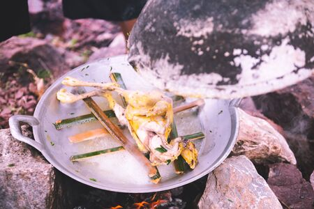 steaming chicken in frying pan, cooking concept