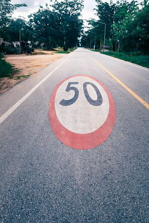 50 mph speed limit sign painted on road Stok Fotoğraf