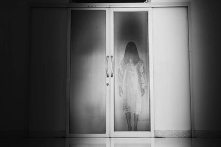 horror woman stand at Closed Mirror doors in the operating room Stok Fotoğraf