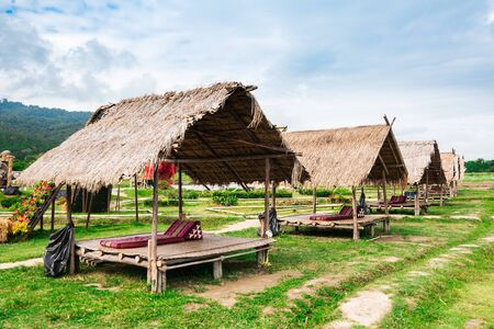A Line of Thai style pavilion with thatched roof outdoor in rice field with pillow Stock fotó