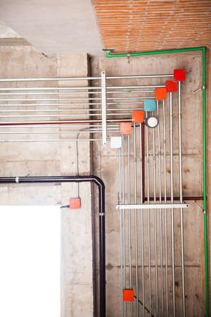 wiring pipe system under concrete wall. Building interior concept
