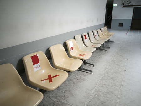 chair for Patients in the hospital with Letter mean do not seat and red mark, social distancing in hospital for coronavirus prevention COVID-19