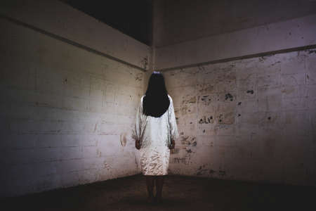 Mysterious Woman, Horror scene of scary ghost woman at the dark corner of old Abandoned building
