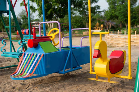 Close up empty swing set playground for children at park