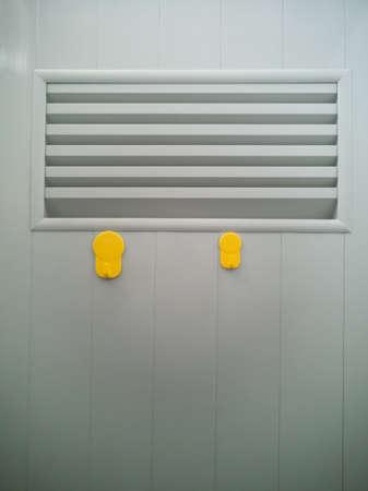 yellow plastic wall hook hangers on door