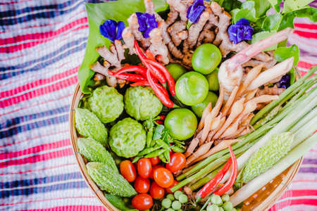 Fresh Asian herb and spicy ingredients food in bamboo basket Stock Photo