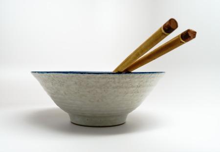 Bowl and Chopsticks Imagens - 27685878