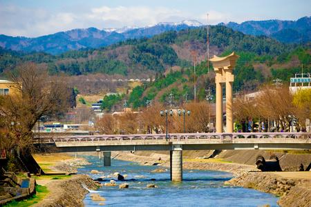 Takayama, Japan - April 4, 2008: Big torii gates of Hachimangu shrine over Miyagawa river in Takayama, Japan. Editorial