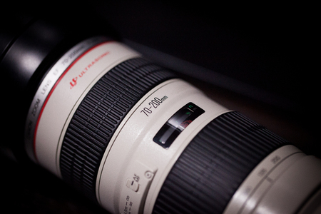 BANGKOK, THAILAND - January 18, 2017: DSLR Camera lens, Canon EF 70-200mm f2.8L USM on a dark background. Low-key studio shot. Editorial