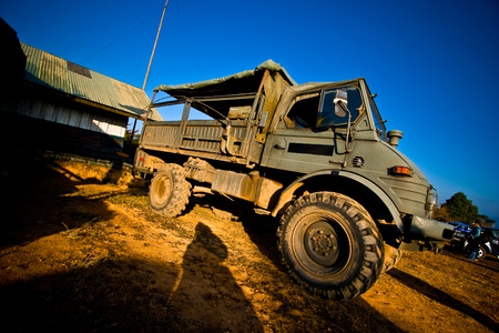 Chiangmai, Thailand - December 2, 2010: Abstract view angle of military truck with morning sunlight and blue sky.
