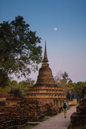 Ancient ruin temple and pagoda at Sukhothai Historical Park, in Thailand.