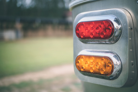 Close up red and yellow classic taillight of travel trailer.
