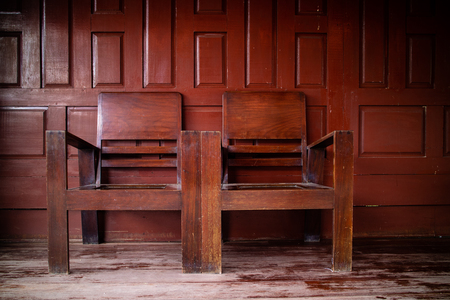 A pair of two old style retro vintage chairs in Thai house.