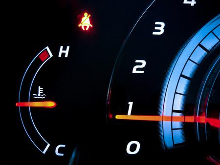Close up of car dashboard in the dark.