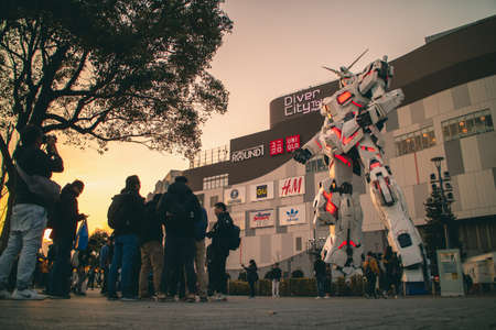 Tokyo / Japan - March 15, 2019: Full scale, full sized of Unicorn Gundam (RX-0) statue in front of Diver City Plaza Tokyo, Odaiba.