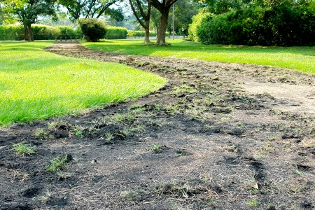 old way with earth on grass field. photo image photo