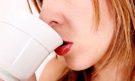 Woman drinking coffee on white cup. Detail Stock Photo - 5879363