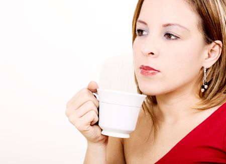 Young woman drinking coffee over white background photo