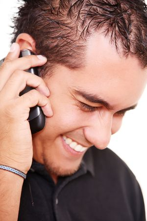 A young man talking on his mobile phone photo