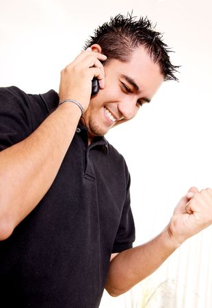 Young man talking on his mobile phone to receive good news Stock Photo - 5879658