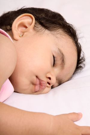 Cute baby sleeping on a white pillow photo