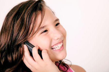 Girl talking on her mobile phone and smiling. Image space to insert your design or text Stock Photo - 5879656