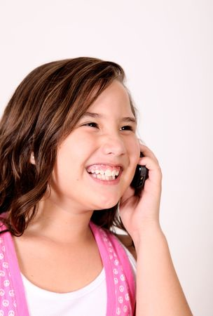 Girl talking on her mobile phone and smiling. Stock Photo - 5879659