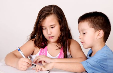 Girl and boy studying together at a table Stock Photo - 5955182