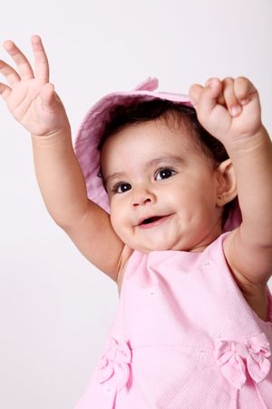 Beautiful baby. Happy with their hands up. Pink dress Stock Photo - 5879521
