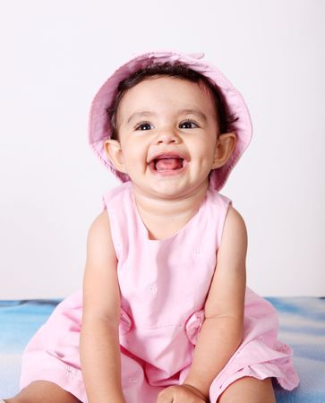 Beautiful baby looking up, Smiling and with pink hat Stock Photo - 5879561