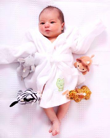 Newborn Baby on white background with animals toys photo