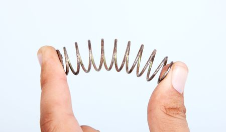 metal spring: Spring on hand over white background. Conceptual image