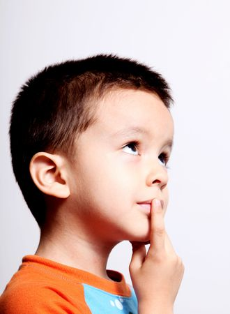 creative thinking: boy thinking and looking up over white background Stock Photo