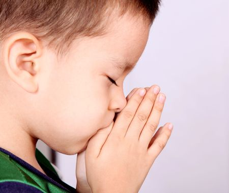 worship white: Child pray over white background. Beauty image