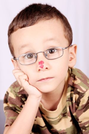 Child with lenses thinking and looking at camera photo