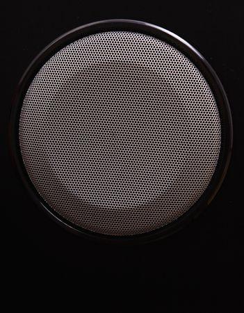 Gray speaker over black background. Sound image photo