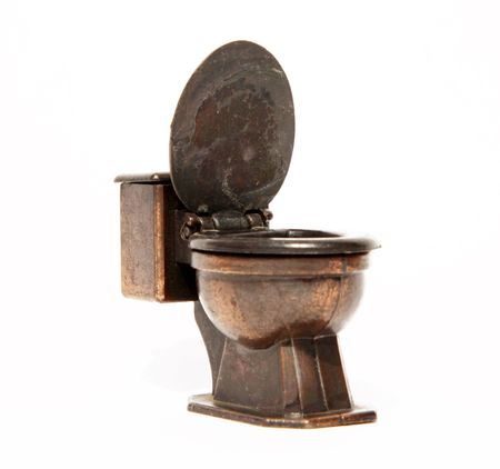 Old bronze toilet over white background. Isolated photo