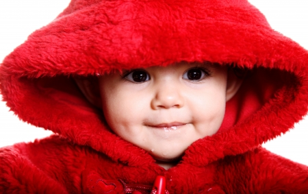 face cloth: Front view. Beautiful baby with red hood over white background Stock Photo