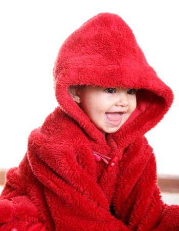Smiling baby with red hood over white background photo