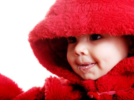 drool: Beautiful baby with red hood over white background Stock Photo