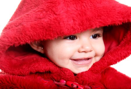 Beautiful baby with red hood over white background photo