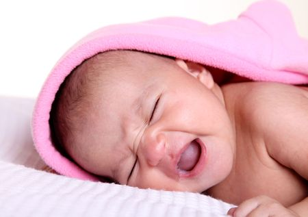 Baby crying with pink blanket over white background Stock Photo - 5955214
