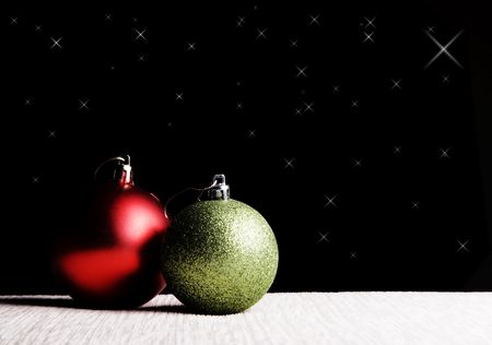 Red and green christmas balls over black background photo