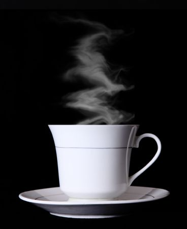 White Coffee cup over black background with smoke  photo