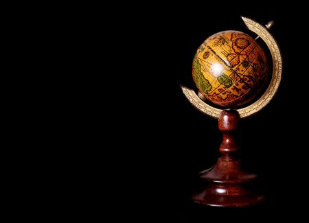 Old world over black background. Space to insert text or design Stock Photo - 6069105