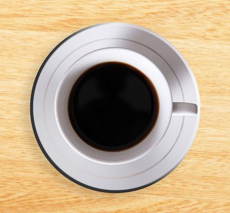 High view of coffee cup over wooden surface photo