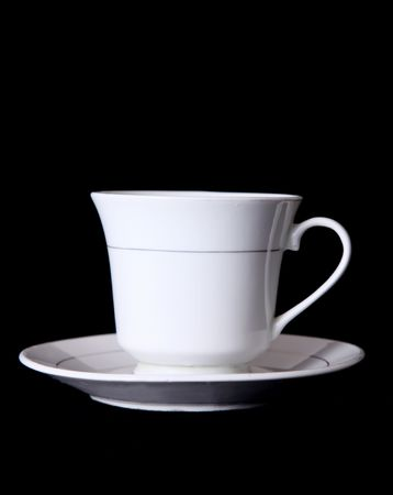 White coffee cup over black background. Front view photo