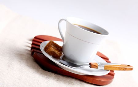 cofffee: White cofffee cup with sugar and spoon on wooden tray