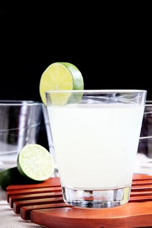 Glass of lemonade on wooden tray over black background Stock Photo - 6099591